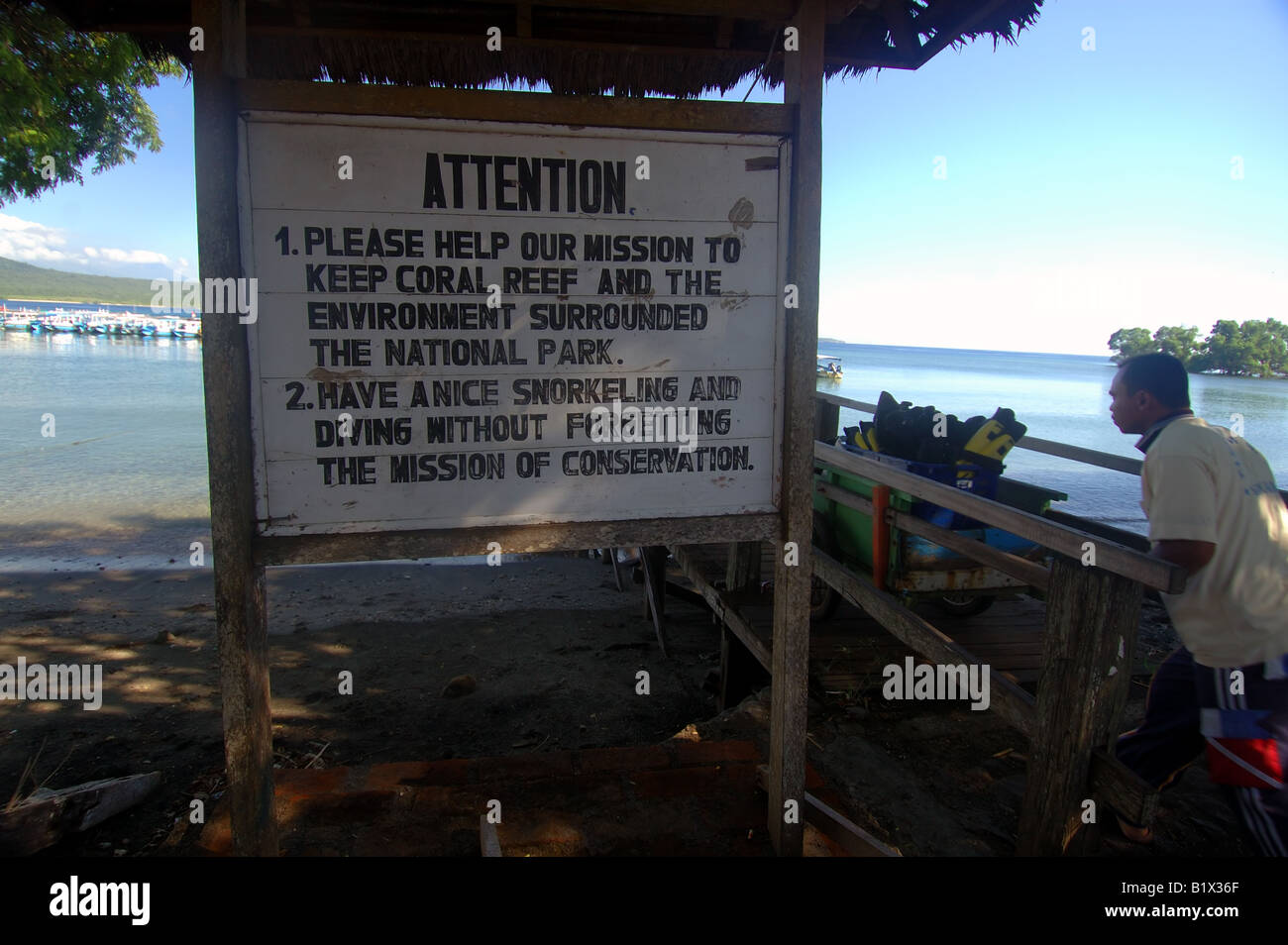 Sign advising tourists that the area around Pulau Menjangan is a conservation park, harbour of Labuhan Lalang, No - Stock Image