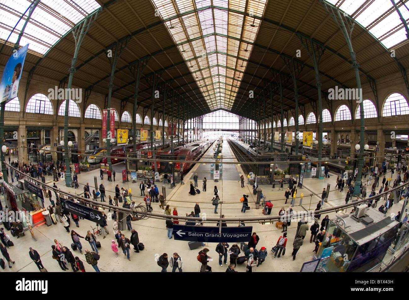 Trains, platforms, and passengers in Paris Gare du Nord France Europe EU - Stock Image
