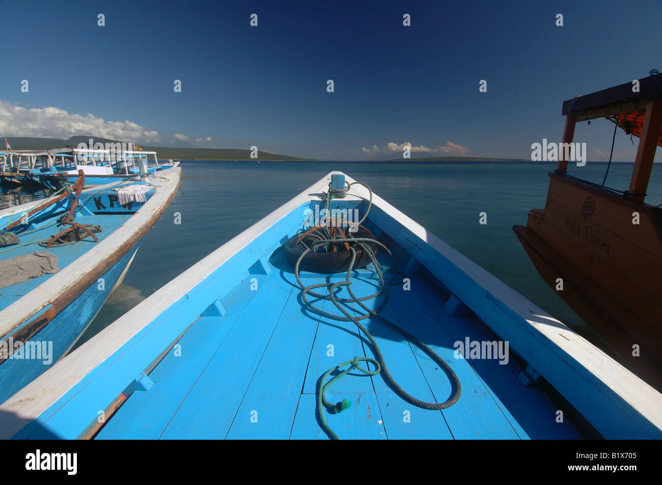 Local boats prahu in the harbour at Labuhan Lalang - Stock Image