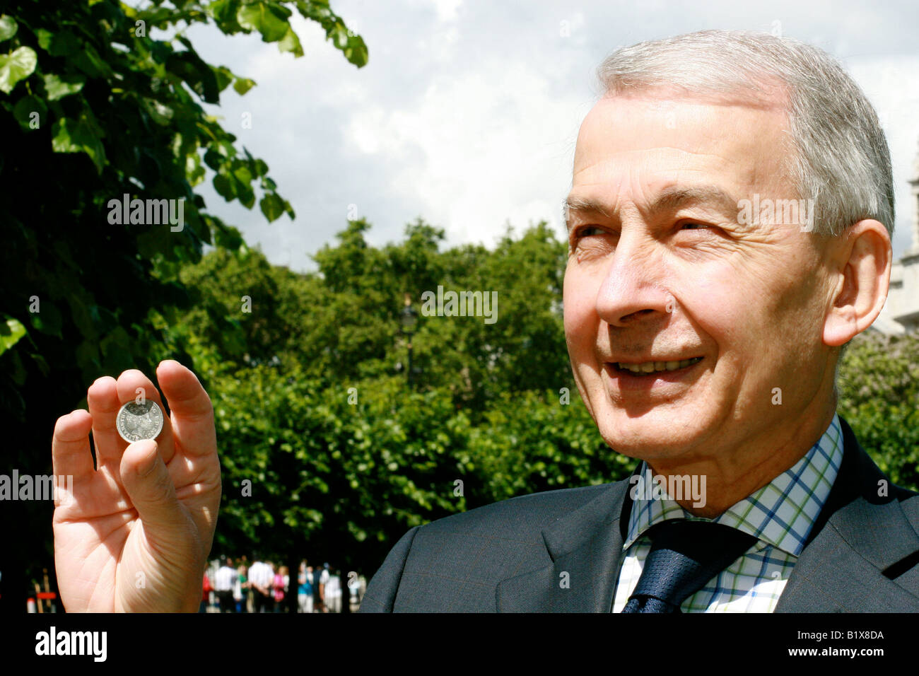 Frank Field holds up a ten pence coin after leading the fight against the government proposed 10p Tax. Stock Photo