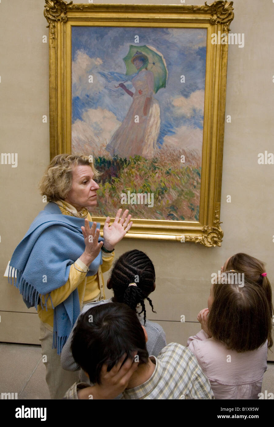 Teacher with young french schoolchildren looking at Monet painting Musee D'Orsay Paris France - Stock Image