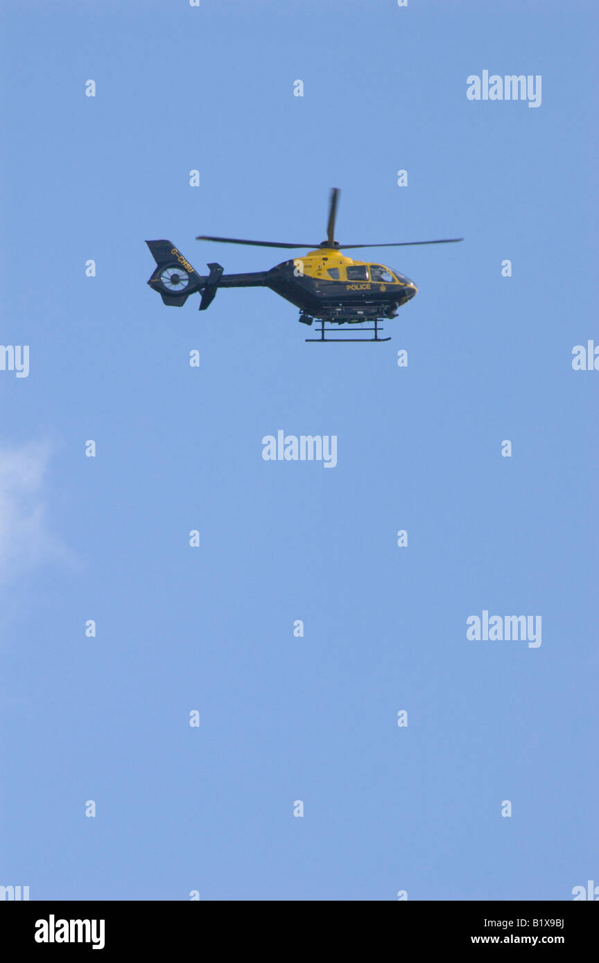 A Thames Valley Police helicopter searching the fields near Ma rlow, Buckinghamshire, UK 1/5 - Stock Image