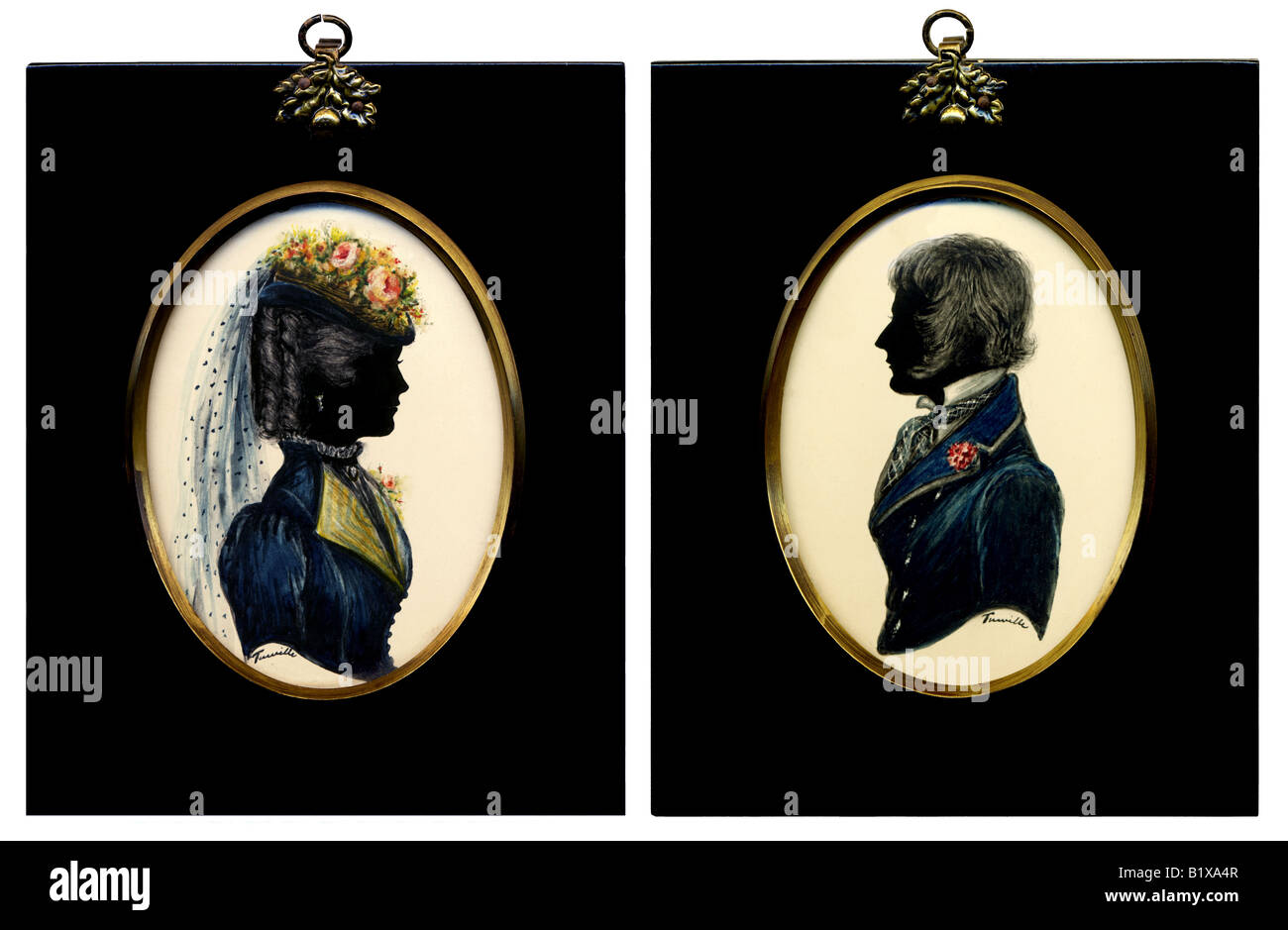 A pair of Georgian style painted miniature silhouettes behind convex glass from the 1970s  FOR EDITORIAL USE ONLY - Stock Image