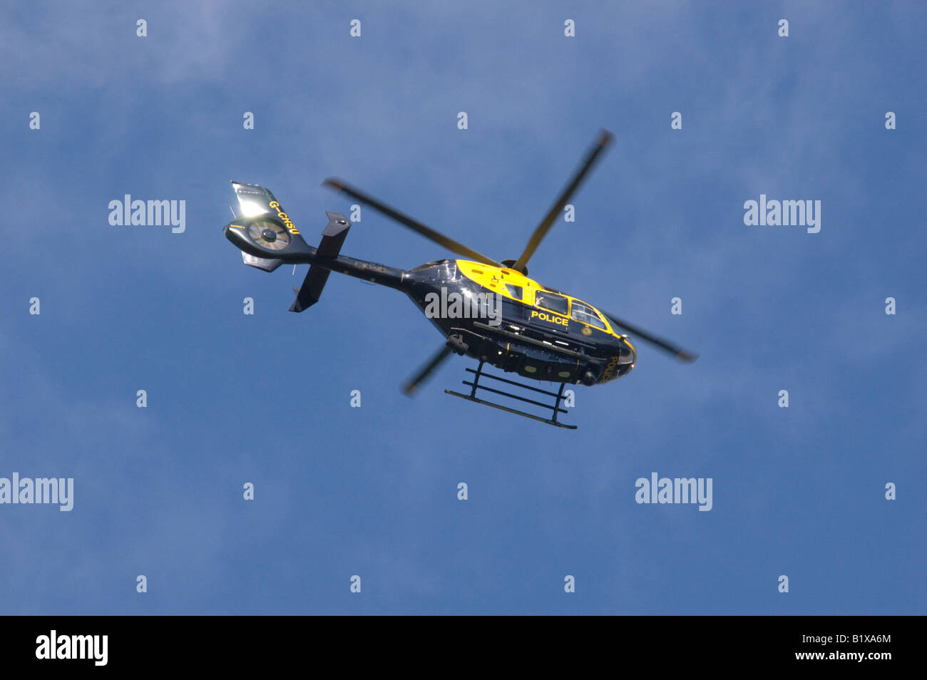 A Thames Valley Police helicopter searching the fields near Ma rlow, Buckinghamshire, UK 4/5 - Stock Image
