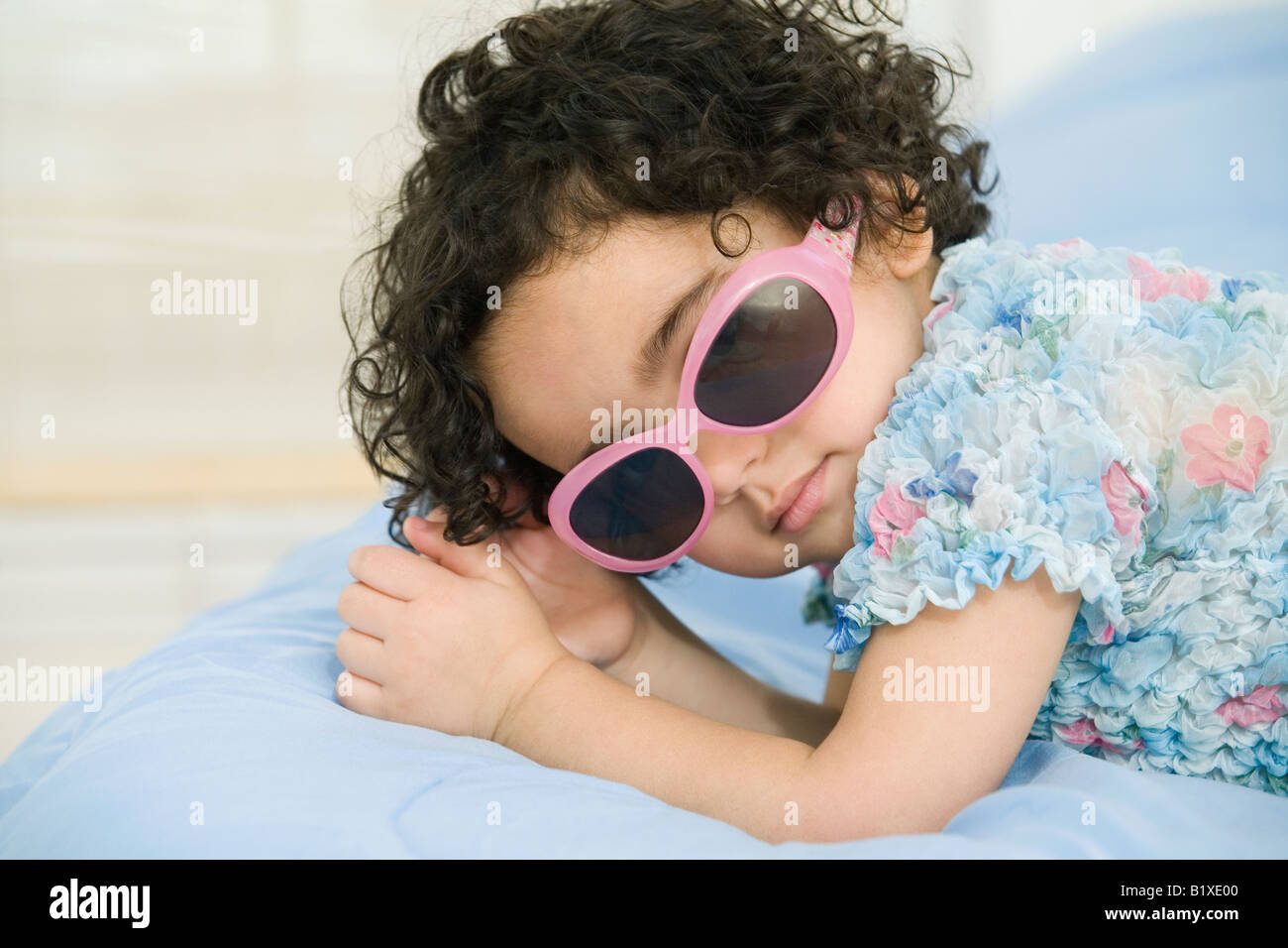Portrait of a girl lying on the bed - Stock Image