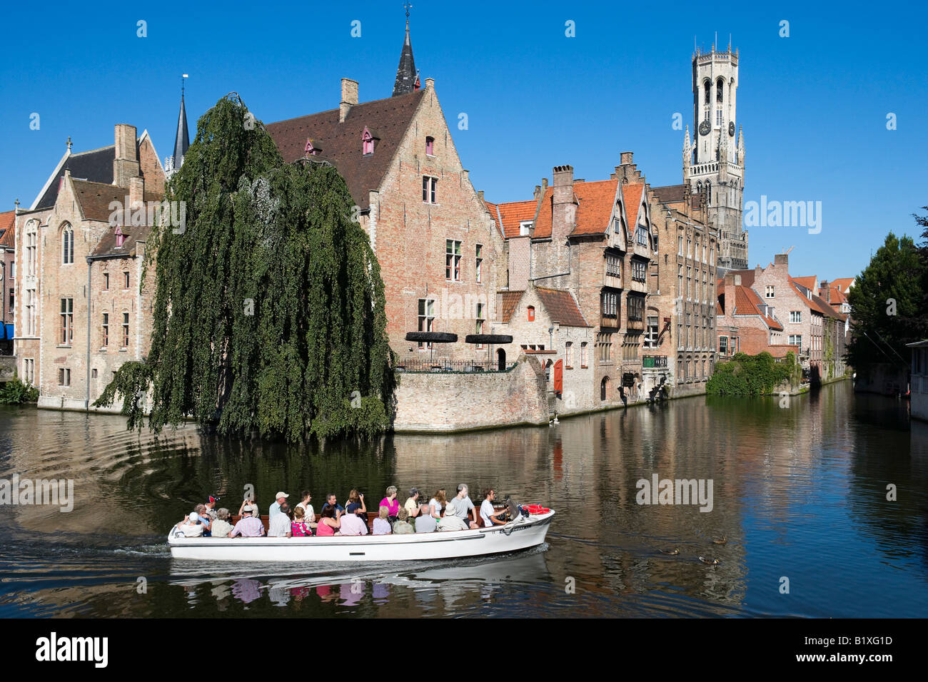 Boat trip on a canal in the old town, Bruges, Belgium - Stock Image