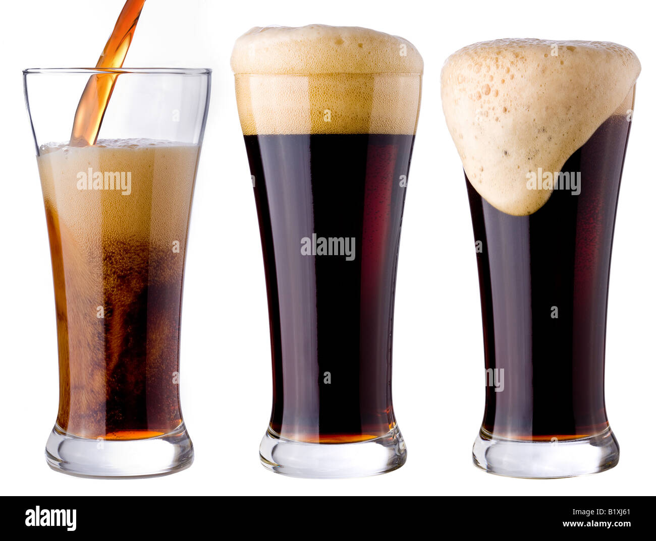 pouring of black beer - Stock Image