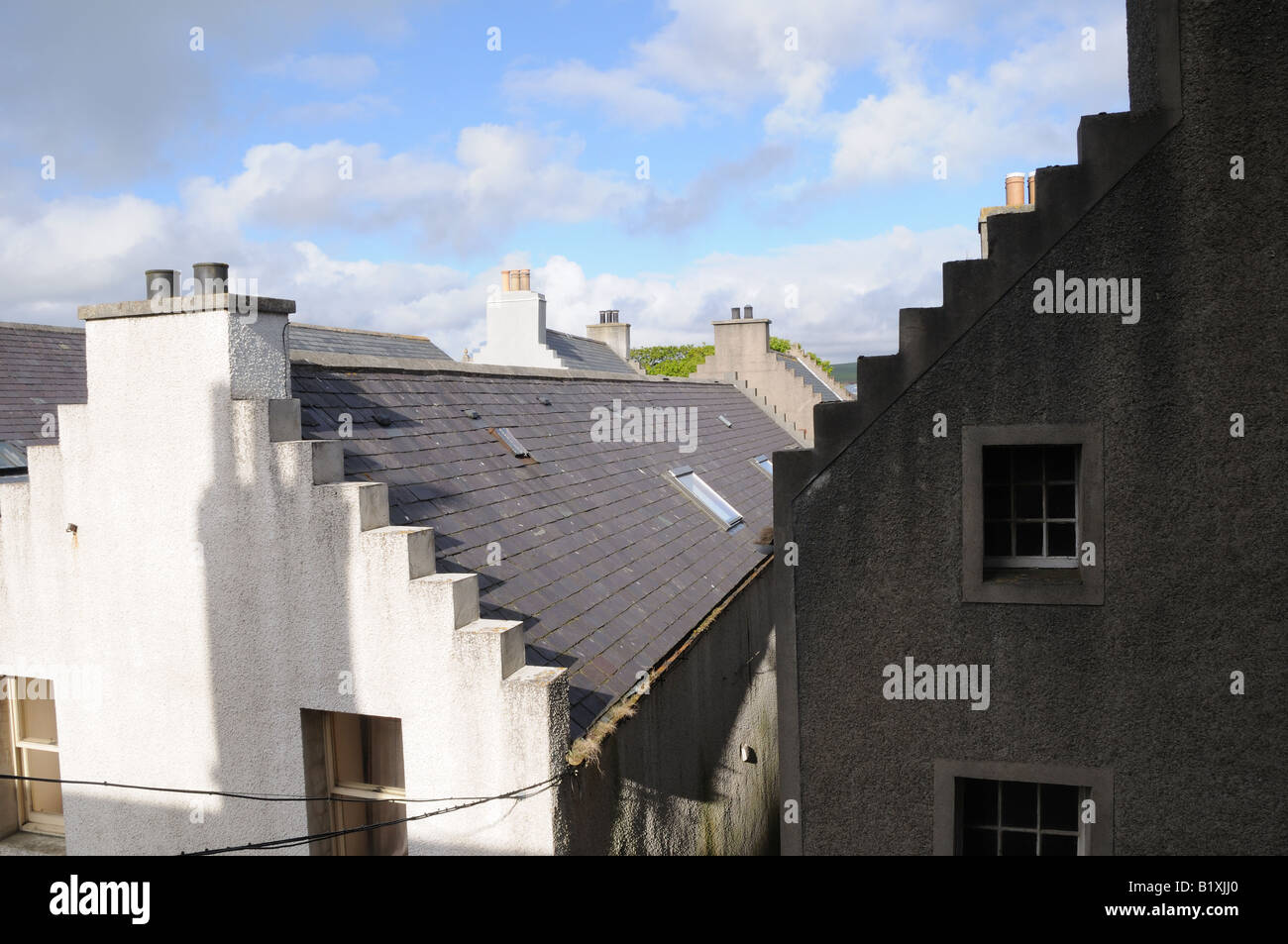 Crow-stepped roof lines on houses in Kirkwall, the capital of the Orkney Islands, are typical of the 17th century. - Stock Image