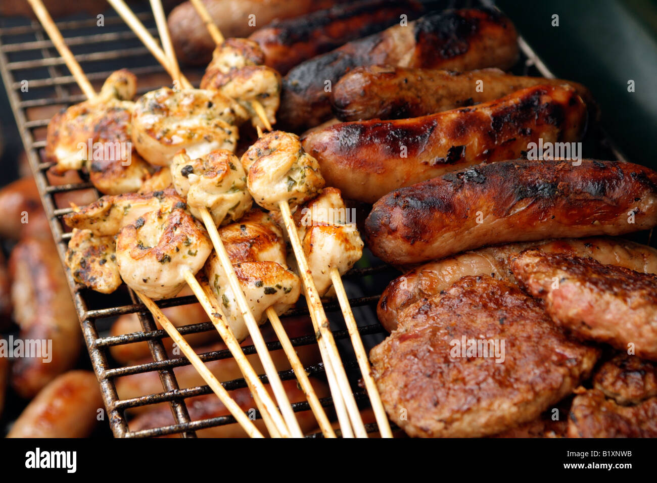food on bbq grill cooking chicken and sausages stock photo 18412951 alamy. Black Bedroom Furniture Sets. Home Design Ideas