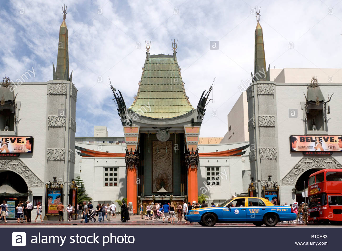 Taxi Driving Past Graumans Chinese Theatre Hollywood California - Stock Image
