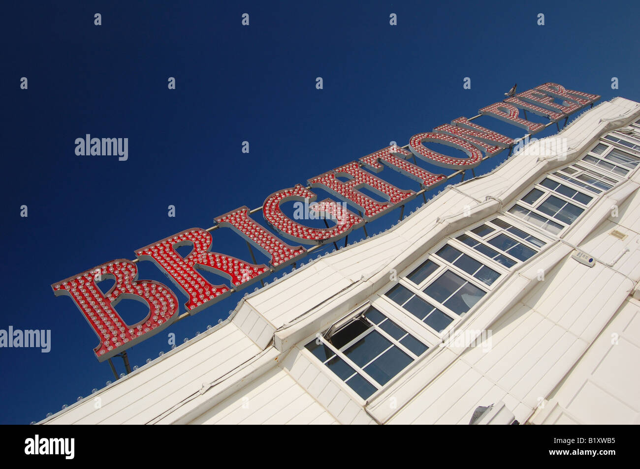 Sign on Brighton Pier with blue sky - Stock Image