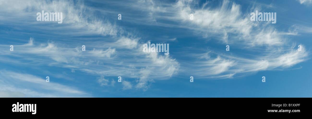 Cirrus Clouds in a bright blue sky in Scotland - Stock Image