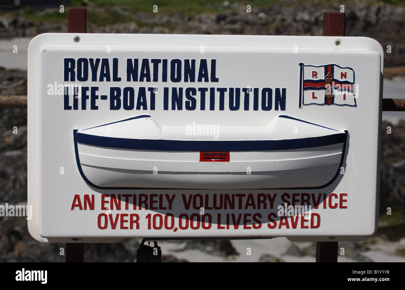 RNLI Lifeboat donation collection box - Stock Image