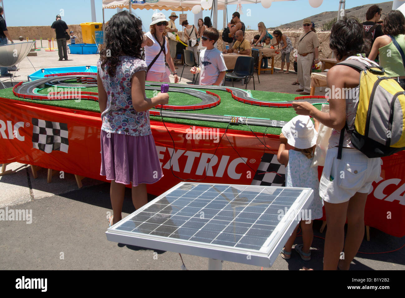 Children playing with solar powered Scalextric set at the Eolica festival of renewable energy on Tenerife in June - Stock Image