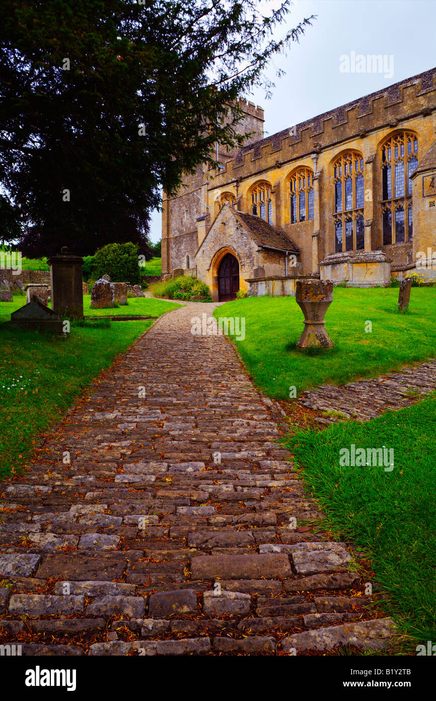 Cobbled Footpath to Parish Church Chedworth Gloucestershire Cotswolds England UK - Stock Image