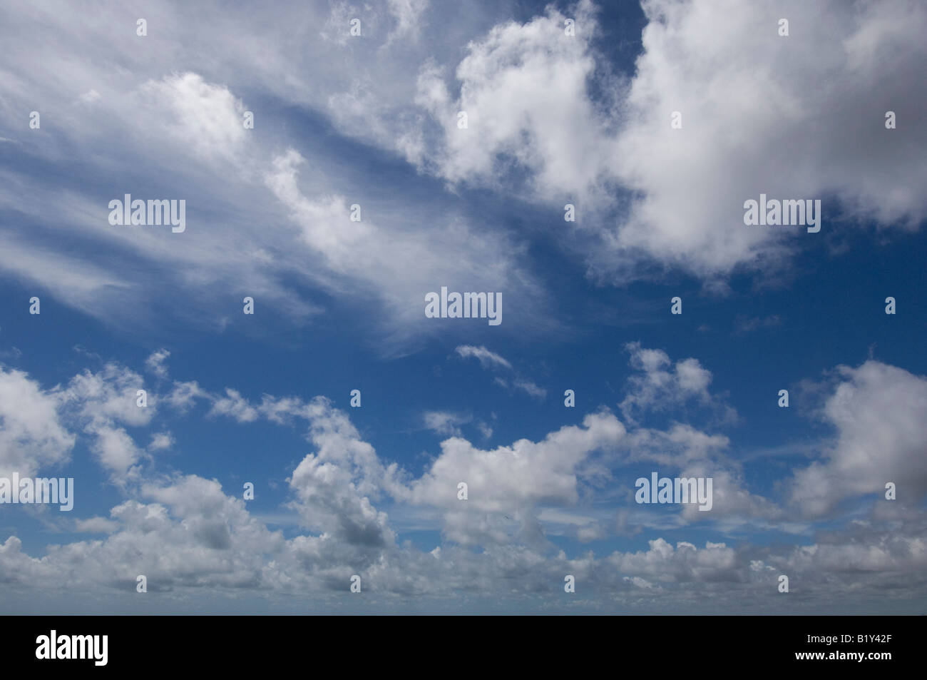 Cirrus and cumulus clouds in blue sky over Sussex UK - Stock Image