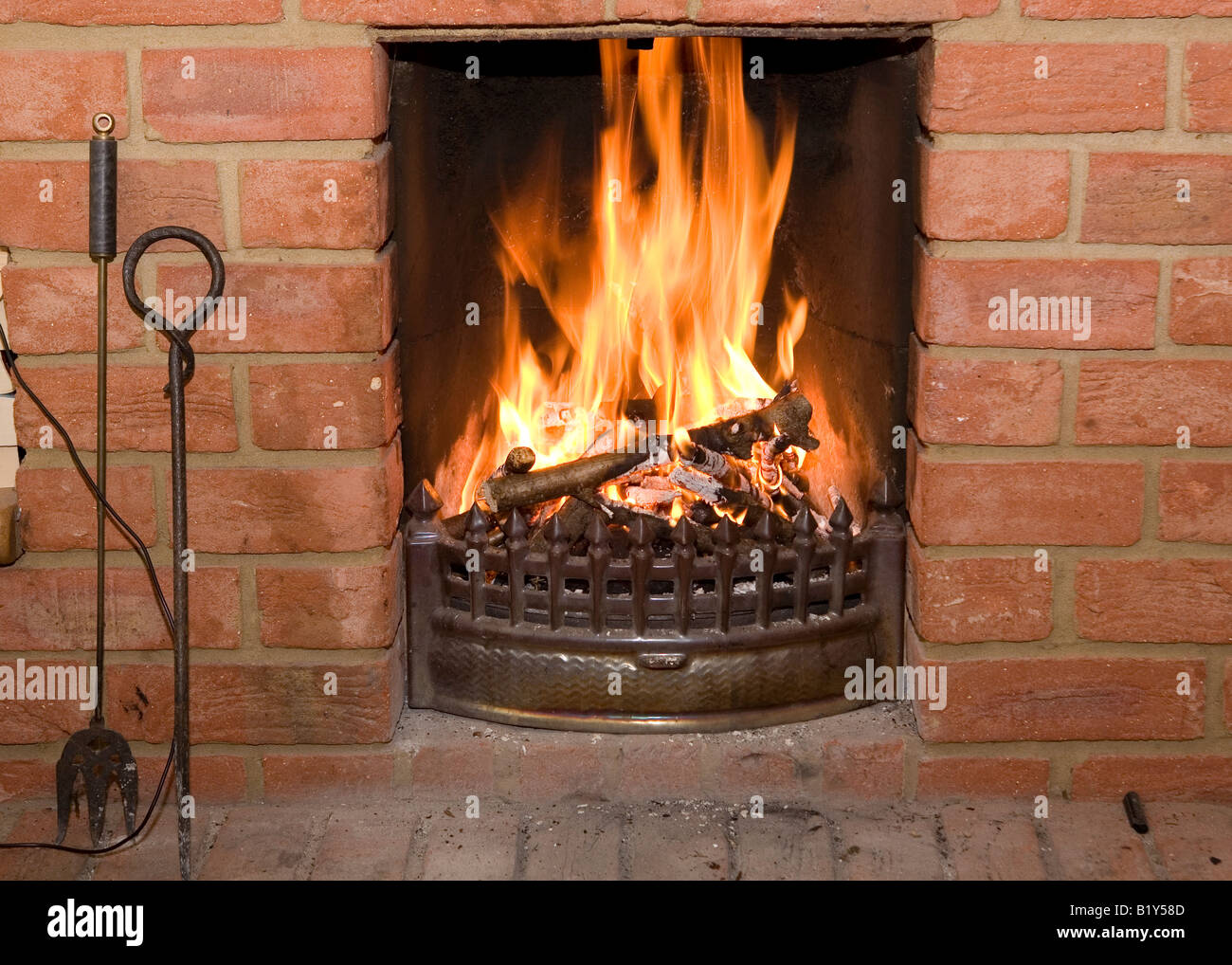 open fire burning in a brick fireplace stock photo 18421885 alamy rh alamy com Fire Brick for Fireplaces Lowe's Brick Tile Fireplace