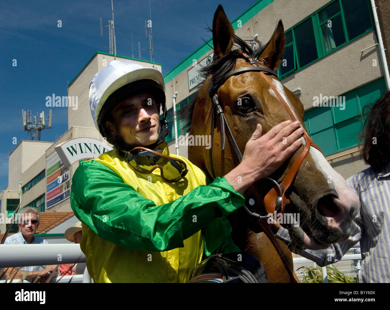 Champion jockey Ryan Moore with Vigano after winning in the second race at Brighton Races Stock Photo