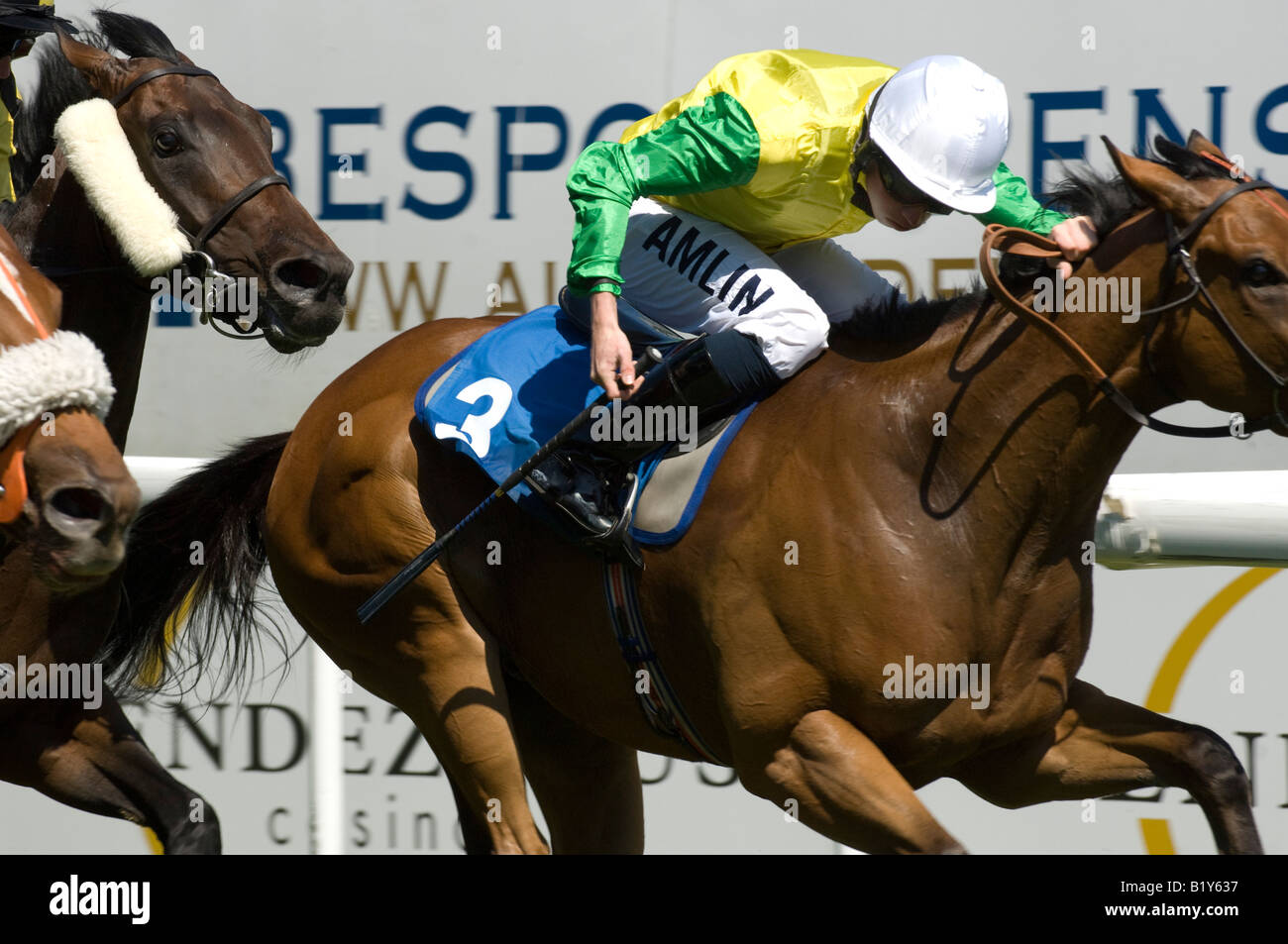 Champion jockey Ryan Moore riding Vigano wins from Benedetto in the second race at Brighton Races - Stock Image