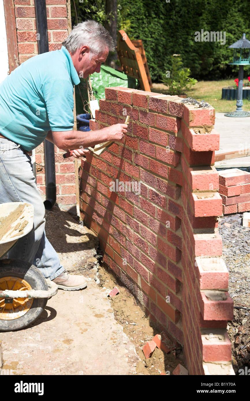Bricklayer Building A Garden Wall Stock Photo 18423226 Alamy