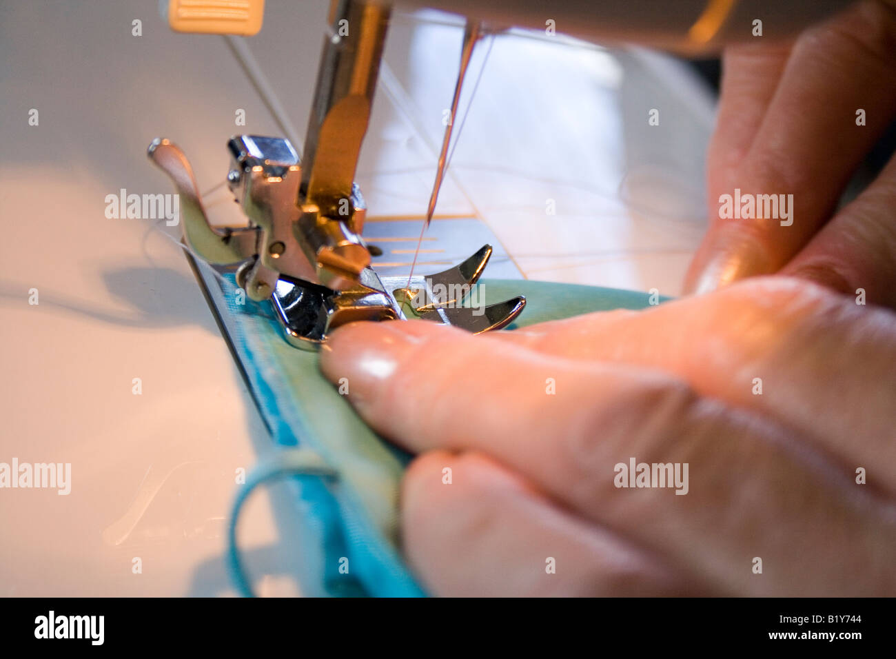 sewing alterations on a bridesmaids dress - Stock Image