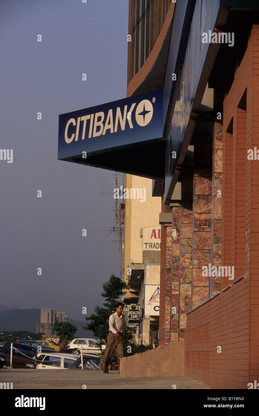 A man enters a US owned Citibank branch office in Islamabad Pakistan - Stock Image