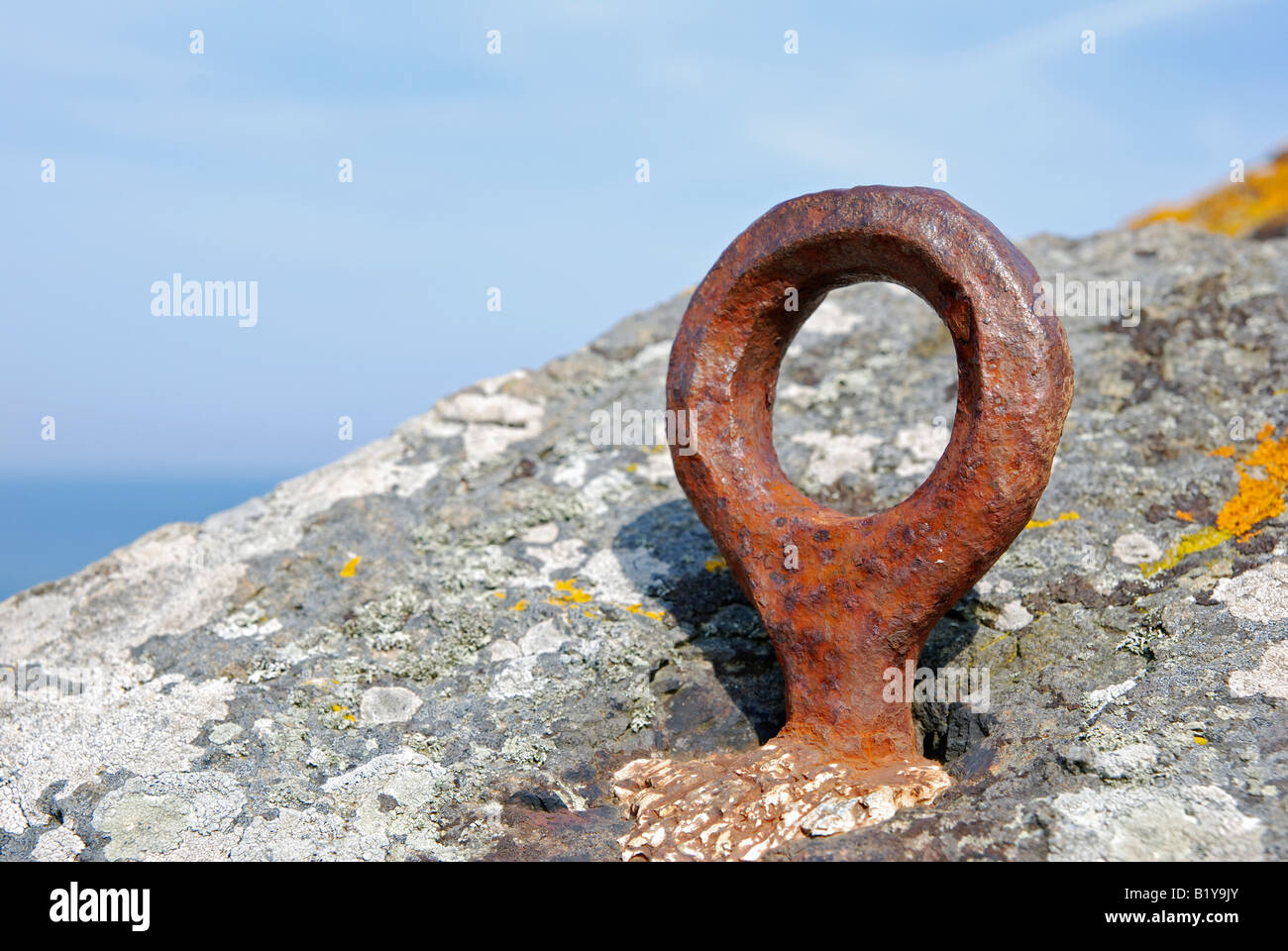 a climbers anchor fixed to the sea cliffs on the north coast of cornwall,england - Stock Image