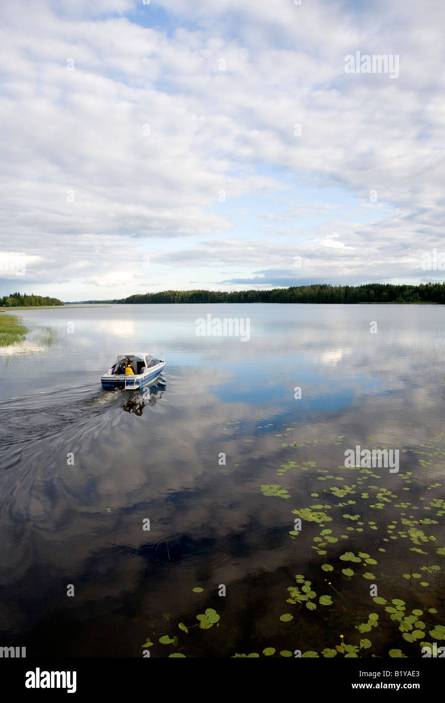Boat entering Lake Suontee Finland - Stock Image