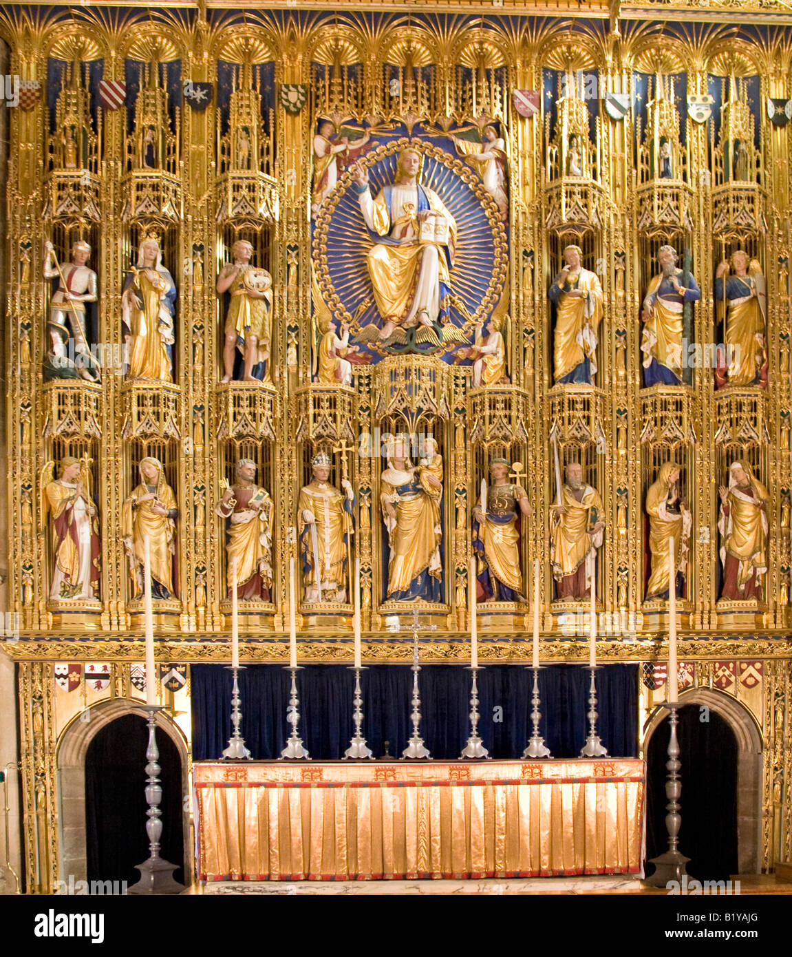 The guilded altar screen at Wymondham Abbey Norfolk England - Stock Image