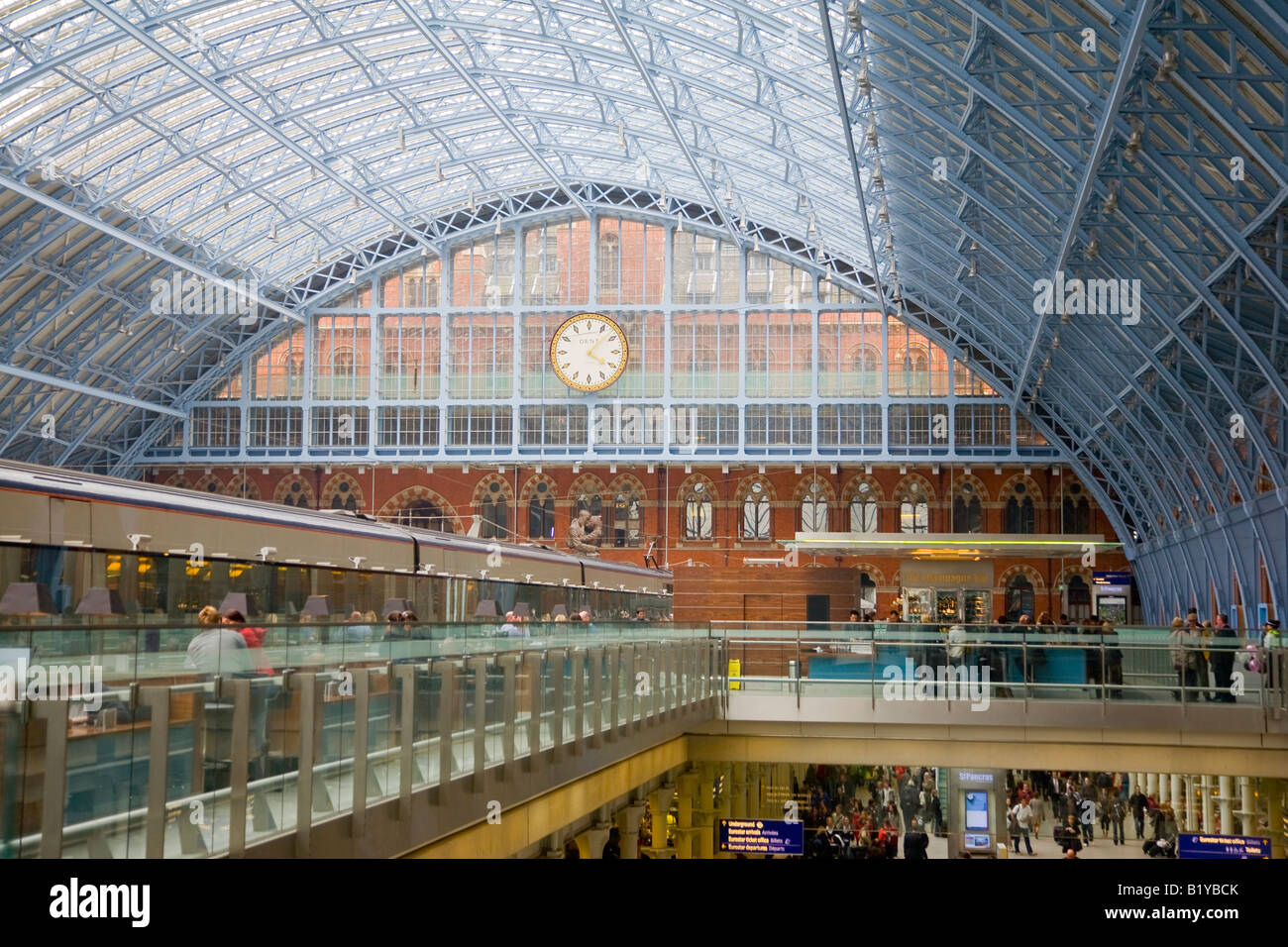 Interior showing the roof and clock in the rebuilt St Pancras Railway Station London England - Stock Image