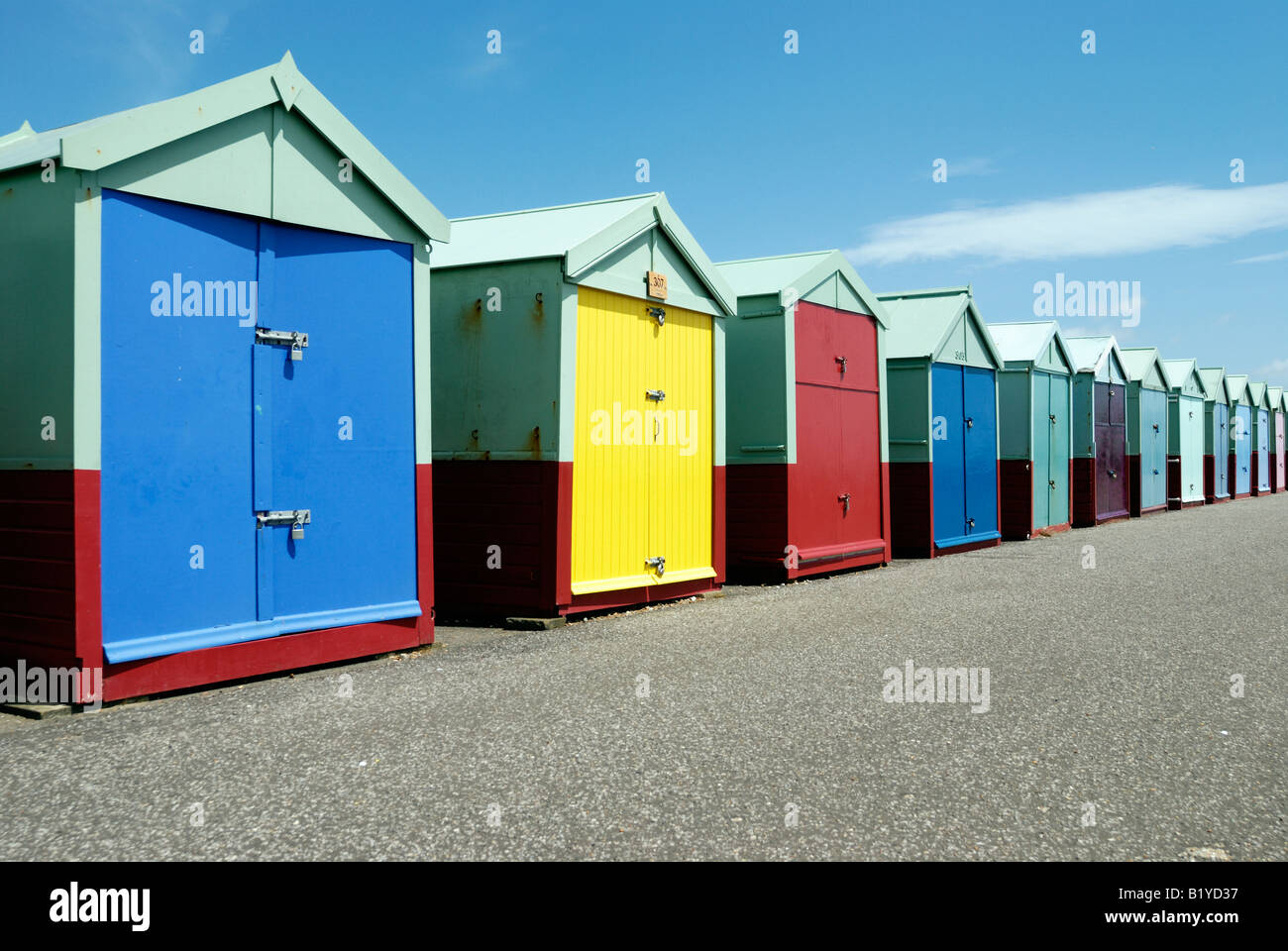 A row of colourful beachhuts on the seafront in Hove Stock Photo
