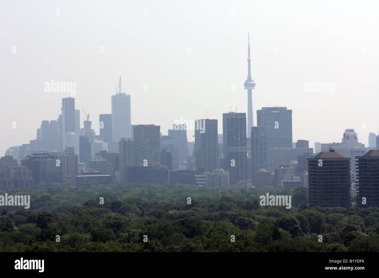 Toronto Downtown fading in smog at 2:45 pm under smog advisory issued by the Ministry of Environment of Ontario Stock Photo