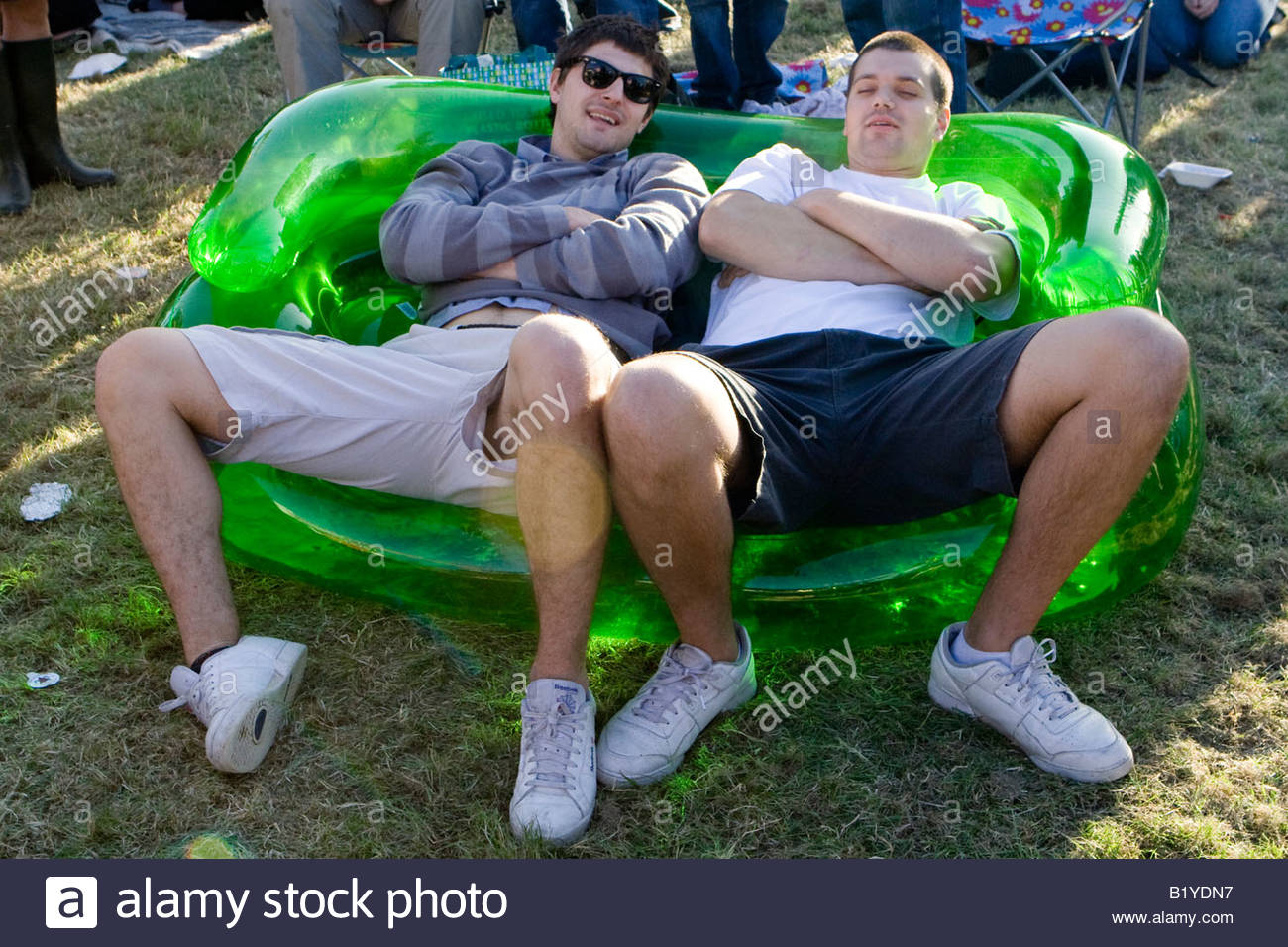 two men on an inflatable sofa the mighty boosh festival at the hop farm in kent england - Stock Image