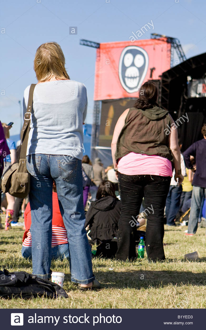 two girls watching gary numan at the mighty boosh festival at the hop farm in kent england - Stock Image