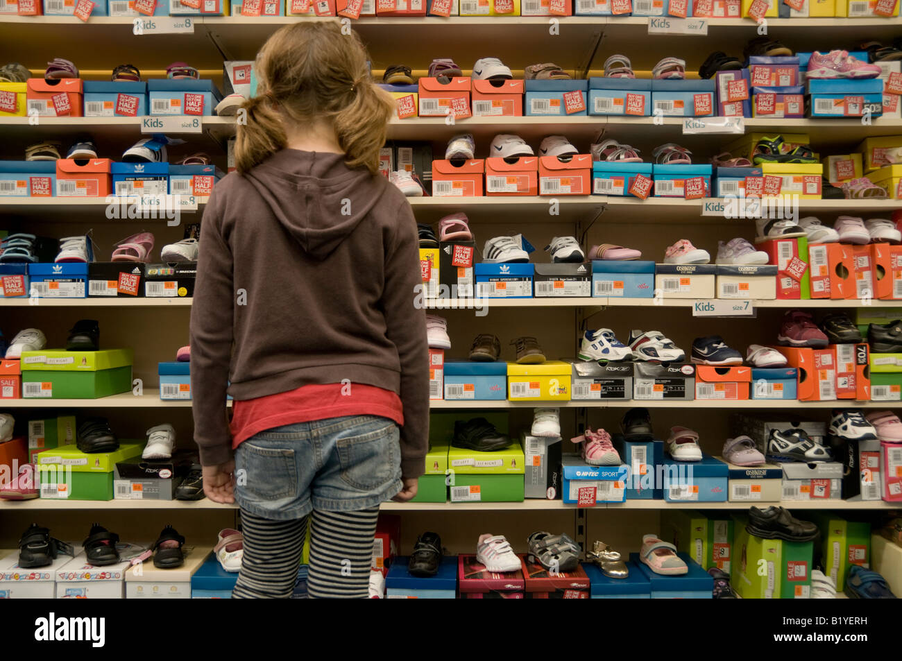 Young girl deciding which pair of cheap
