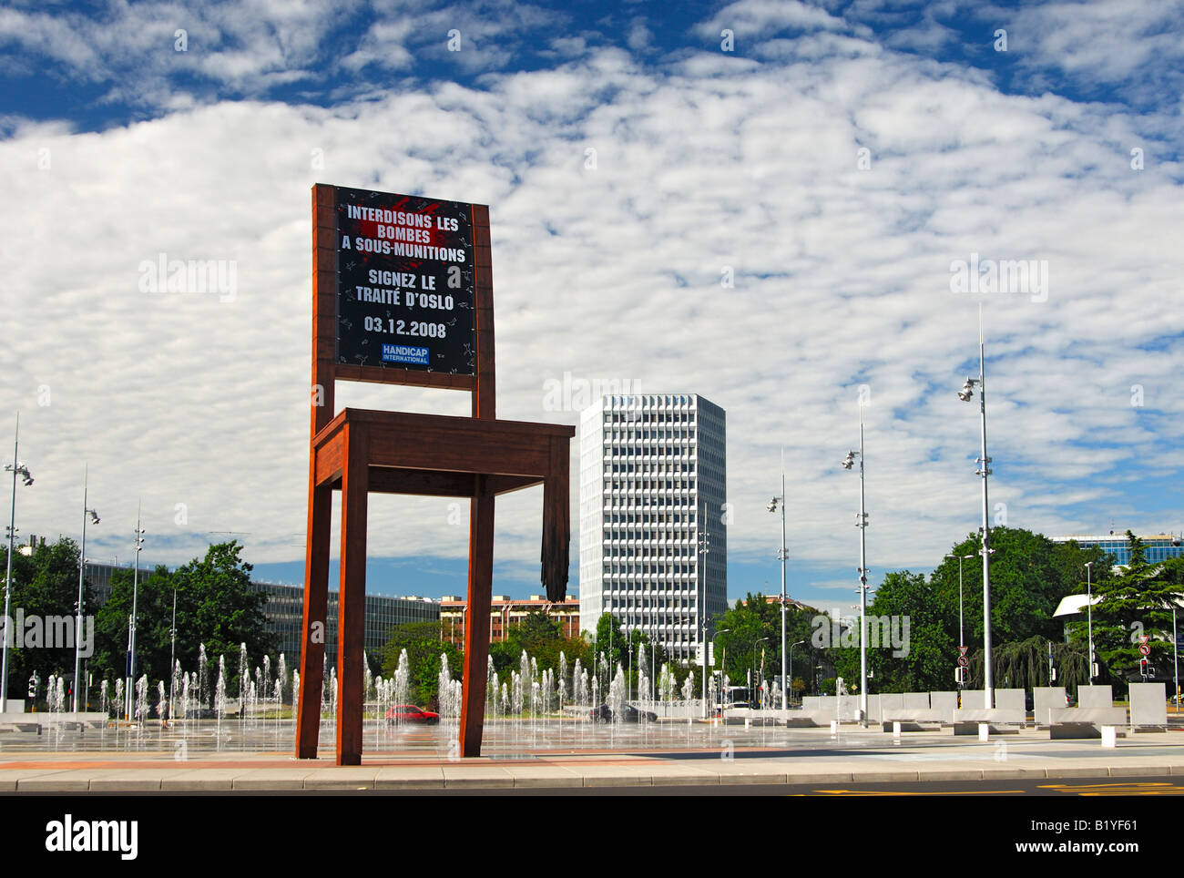 Handicap International demands the signing of the Oslo cluster bomb ban treaty at the Broken Chair memorial, Geneva, - Stock Image