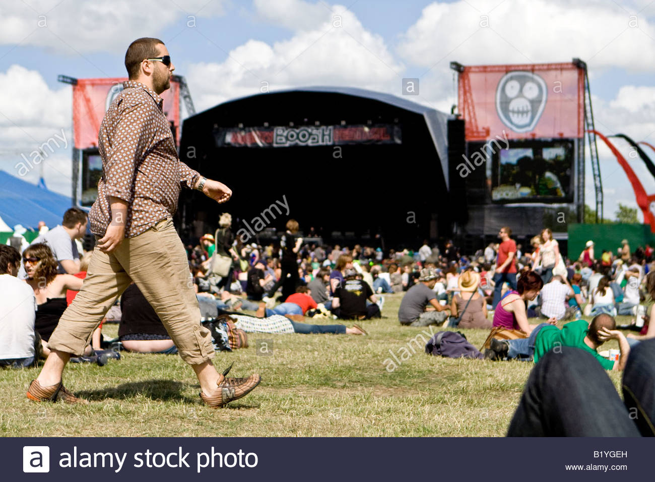 a man strides through the crowds at the mighty boosh festival at the hop farm in kent england - Stock Image