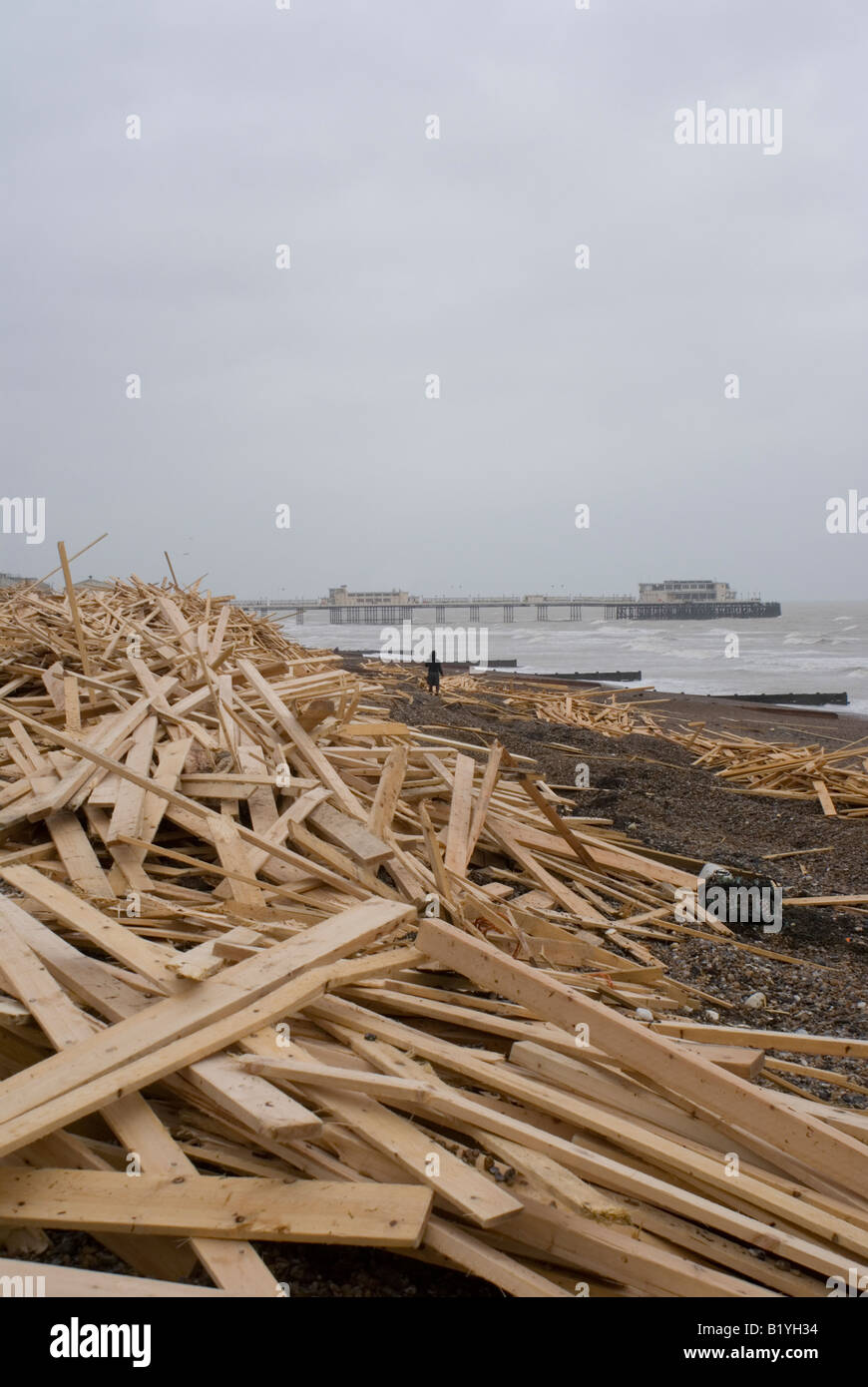 Wooden planks washed up on Worthing beach from a shipwreck. - Stock Image