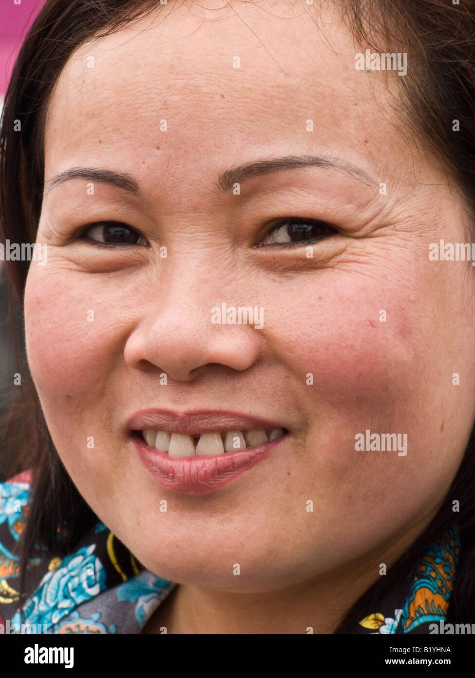 portrait of smiling Vietnamese woman, 40s - Stock Image