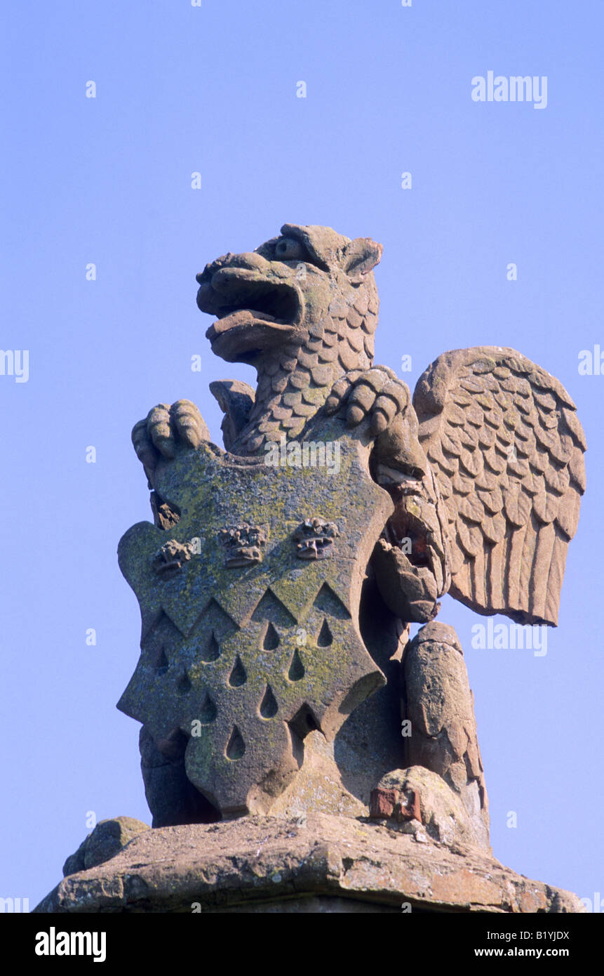 Winged Griffin Knebworth House Hertfordshire Coat of Arms Shield Armorial device stone carved statue England UK - Stock Image