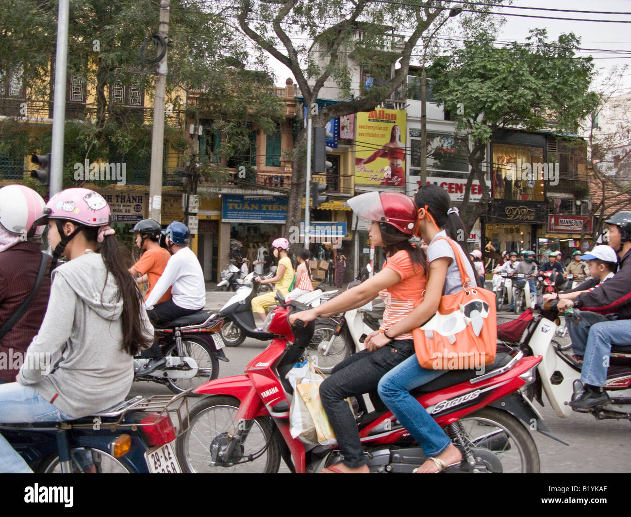 motorbike traffic in busy street in Hanoi, Vietnam - Stock Image