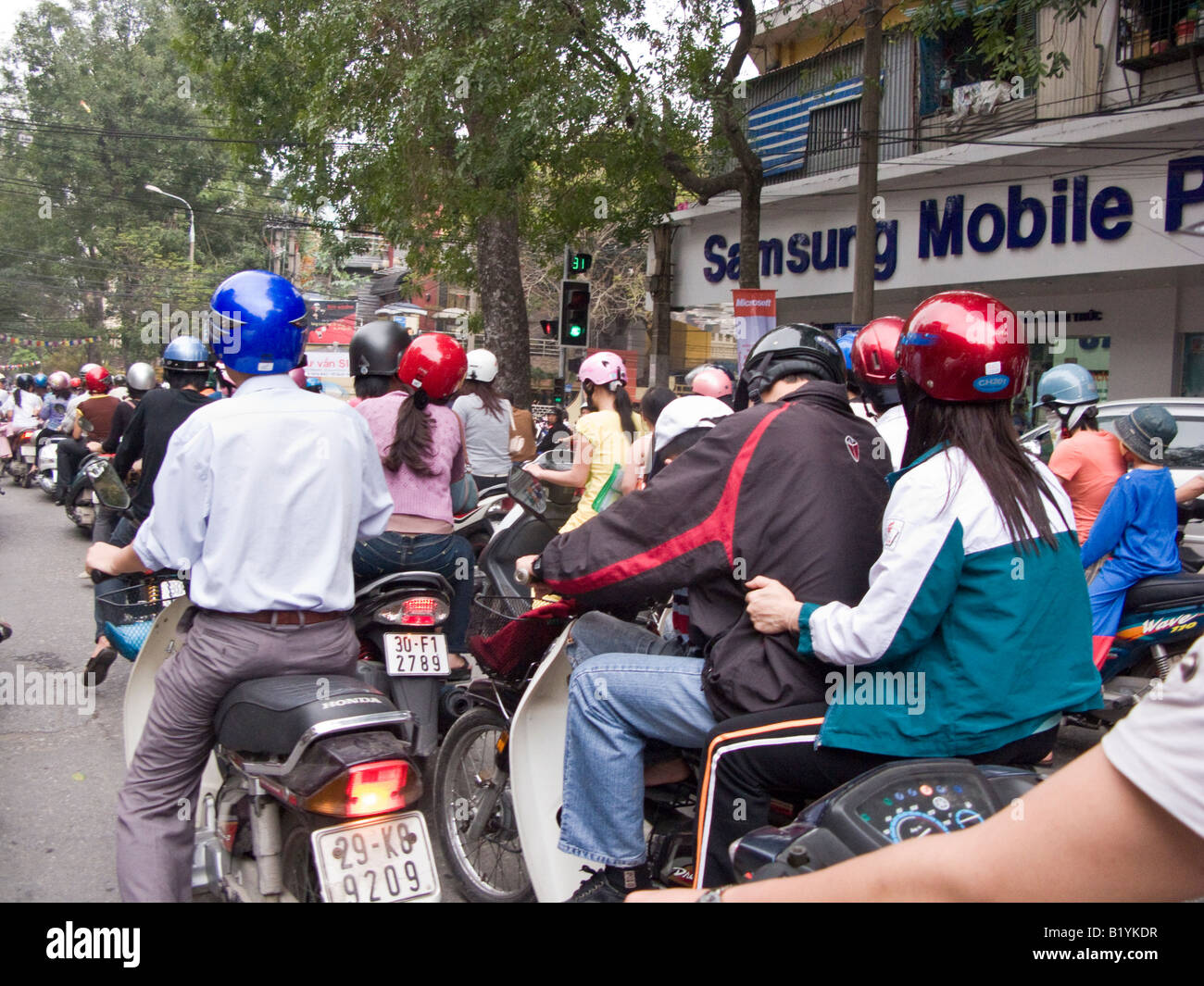 motorbike traffic in busy street in Hanoi, Vietnam - Stock Image