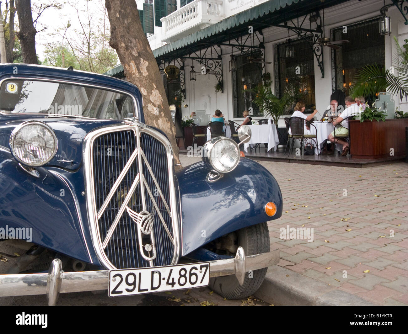 Citroen traction avant 1940s car in front of Sofitel Metropole Hotel, Hanoi, Vietnam Stock Photo