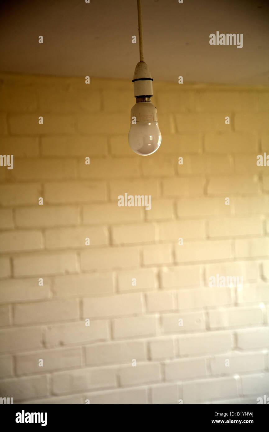 lightbulbs bare. Single Bare Light Bulb Against White Painted Brick Wall Of Military Building - Stock Image Lightbulbs B