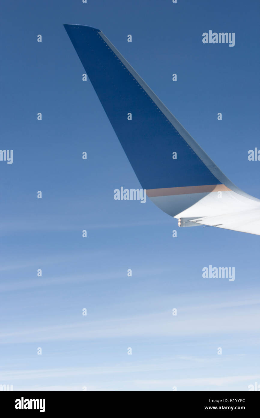 Airplane wing  during fly. - Stock Image