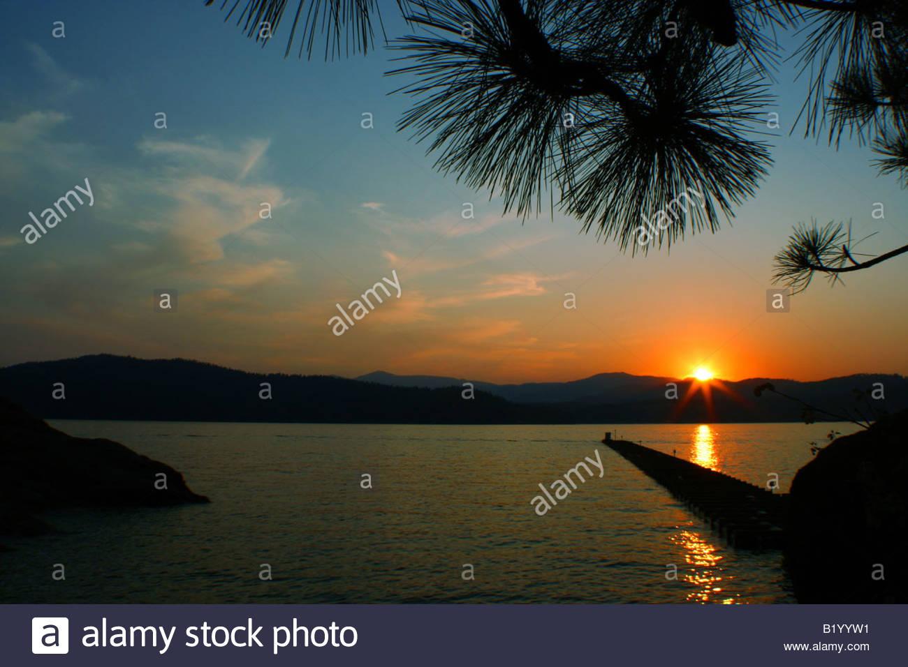 A Beautiful sunset over a lake. - Stock Image