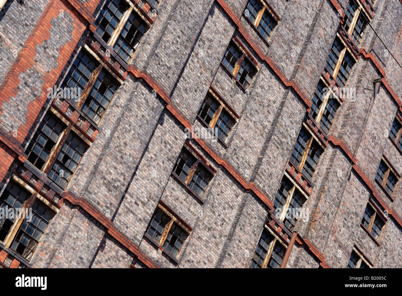 Detail on the Grade II listed buildings of the Tobacco Warehouse complex at Stanley Dock by Liverpool Docks Stock Photo
