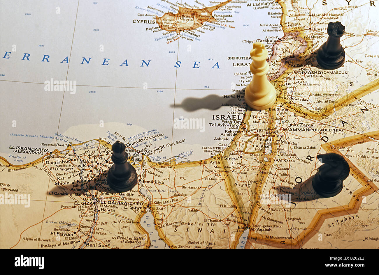 Chess pieces on map of israel egypt jordan and syria stock photo chess pieces on map of israel egypt jordan and syria gumiabroncs Images