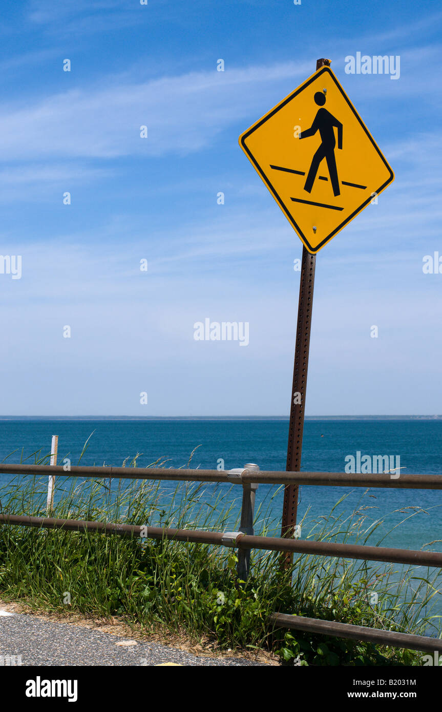A pedestrian sign over looking the ocean in Martha's Vineyard Massachusetts. Stock Photo