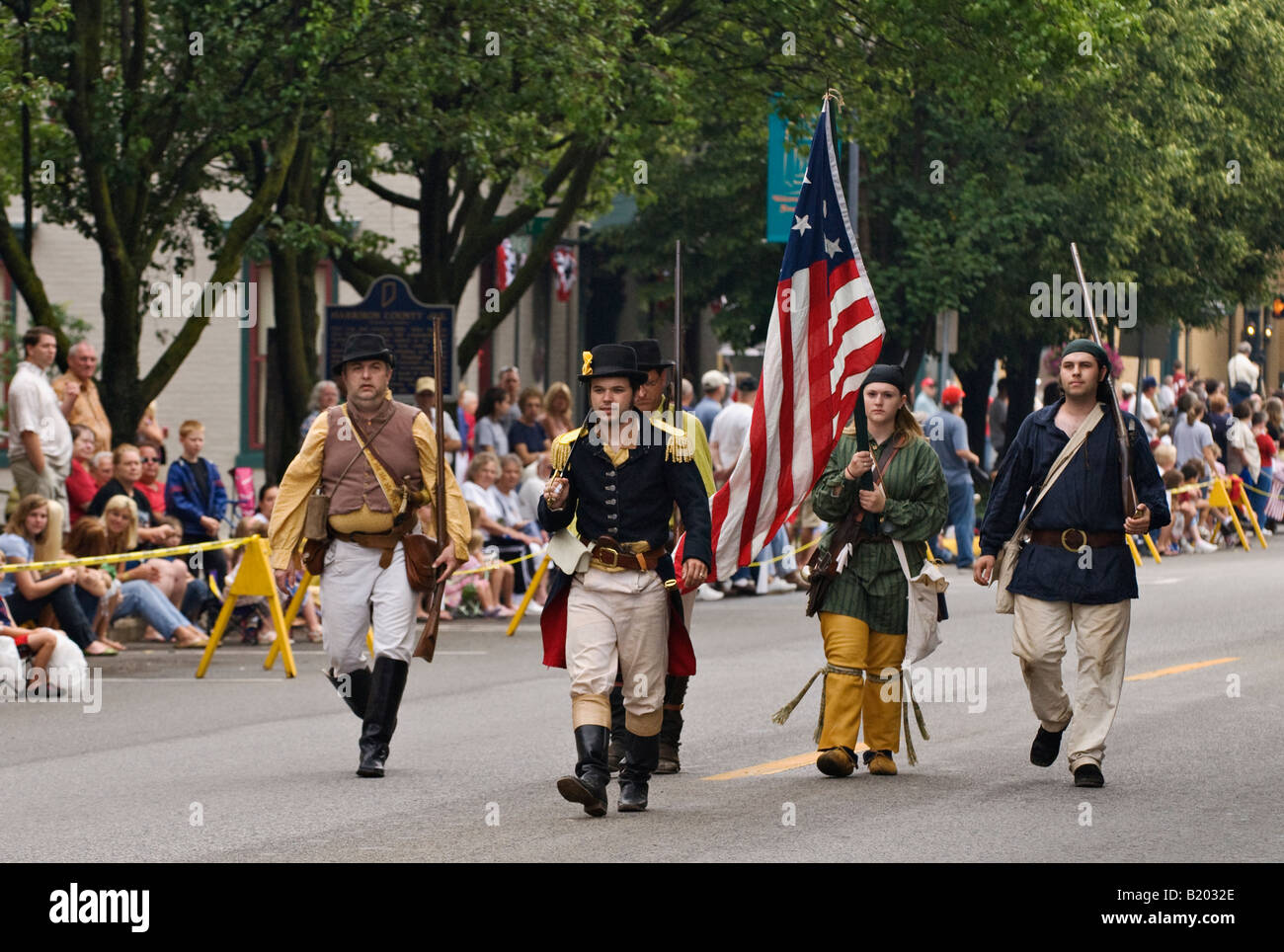Reenactment Group Carrying American Flag in Independence Day Parade Corydon Indiana - Stock Image